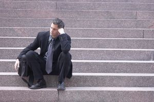 Disappointed Man sitting on step